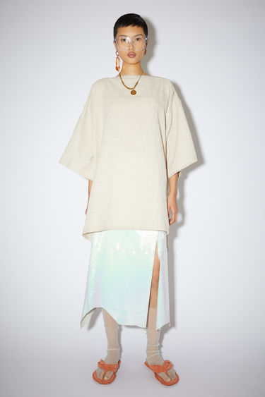 Acne Studios coconut white seersucker dress is made of a cotton/linen blend with a slight stretch.
