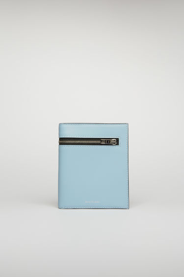 Acne Studios light blue/black trifold wallet is crafted from smooth leather and fitted with zip pockets, receipt partitions and card slots.