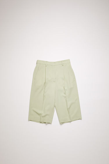Acne Studios pastel green shorts are crafted from a wool-blend and shaped to loose-fitting, straight legs with pleats on the mid waist.