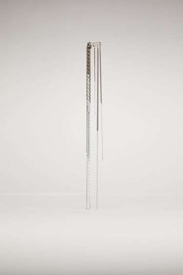 Acne Studios antique silver/white earring is crafted from silver-tone brass and features dangling tassel chains that's secured with a post-back fastening.
