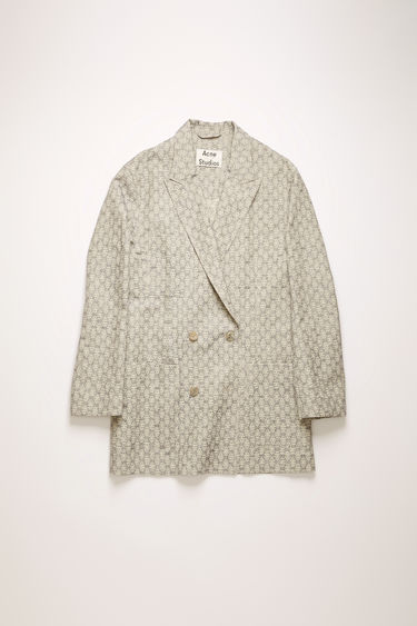 Acne Studios ink blue suit jacket is made from a cotton and linen blend that's jacquard-woven with a floral motif and shaped to a double-breasted silhouette with dropped shoulder seams.