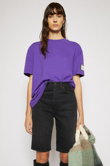 Acne Studios electric purple t-shirt is crafted from organic cotton to an oversized silhouette and adorned with a label patch on the sleeve.