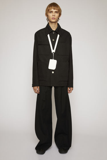 Acne Studios black jacket is cut from cotton twill to a boxy silhouette and features four patch pockets and branded rivet buttons.