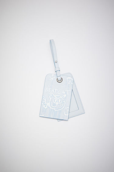 Acne Studios pale blue luggage tag is made of leather with an all over Welcome to Stockholm bleached print.