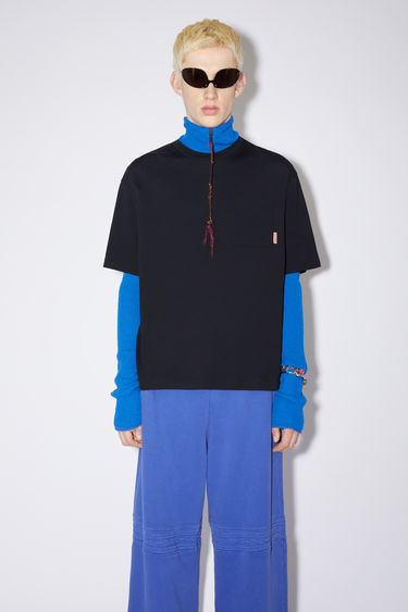 Acne Studios black t-shirt is crafted from organically grown cotton that's enzyme-washed to create a soft handle. It's shaped to a relaxed silhouette and has a patch pocket and dropped sleeves.