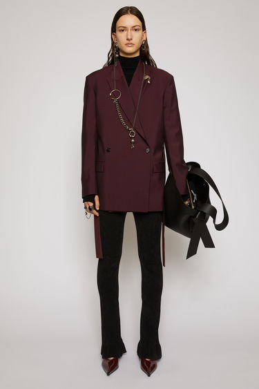 Acne Studios aubergine/black suit jacket is cut from lightweight wool and mohair-blend to a double-breasted silhouette and features peak lapels, dropped shoulders and a waist belt.