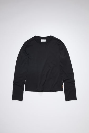 Acne Studios black crew neck t-shirt is made of cotton with long sleeves and an Acne Studios logo tab.