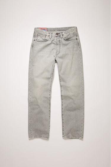 Acne Studios 2003 Stone Grey jeans are crafted from rigid denim that's been washed to give a whiskered, lived-in appeal. They're cut to sit low on the waist and have a dropped inseam that sets a loose silhouette.