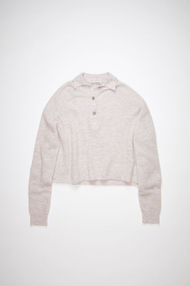 Acne Studios pale pink melange polo sweater is made of a soft, rib knit with a relaxed fit.