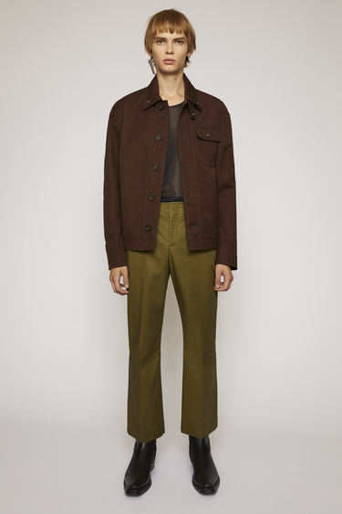 Acne Studios coffee brown deck jacket is crafted to a boxy silhouette from durable cotton-canvas and accented with a buttoned chest pocket and gunmetal hardware on the collar.