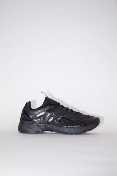Acne Studios black/black/black lightweight lace-up sneakers are lined in mesh.