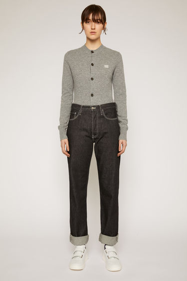 Acne Studios black jeans are crafted from rigid denim to a high-rise silhouette with straight legs and accented with white topstitching and a face-embroidered patch on the back pocket.