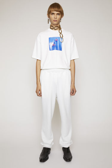 Acne Studios optic white sweatpants are crafted from a midweight loopback jersey to a straight-leg fit and features an elasticated waistband and a reversed label patch above the back pocket.