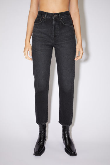 Acne Studios black jeans are made from rigid denim with a high rise and a straight leg.
