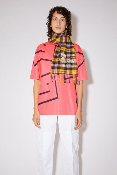 Acne Studios electric pink relaxed fit t-shirt features an oversized face print and ribbed crew neck.