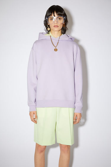 Acne Studios lavender purple hooded sweatshirt features ribbed details and an Acne Studios logo tab.
