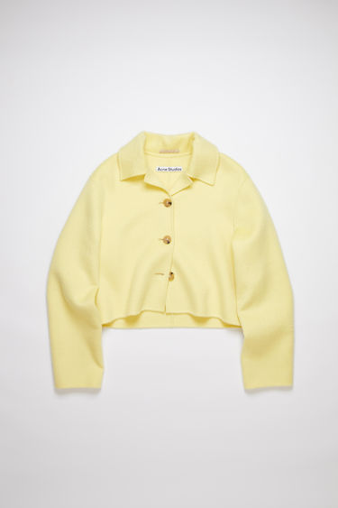 Acne Studios vanilla yellow unlined cropped jacket is made of a wool/alpaca blend with button closures and double face finishings.
