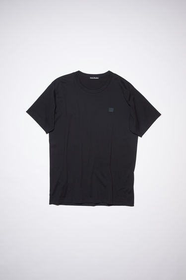 Acne Studios Nash Face black t-shirt is crafted with short sleeves and a ribbed collar from a lightweight cotton jersey and accented with a tonal face-embroidered patch on the chest.