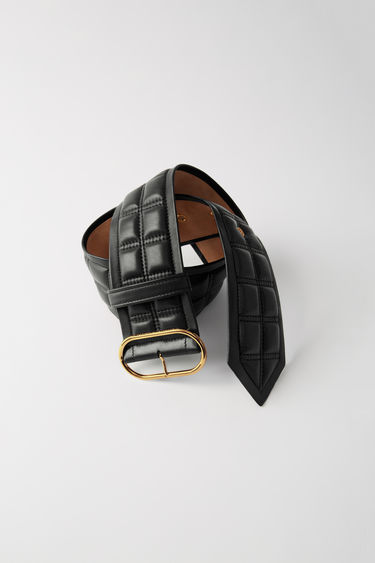Acne Studios black waist belt is crafted from quilted lamb leather and accented with a gold-tone oval buckle.