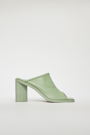 Acne Studios pale green mules are crafted from supple leather with an open toe and set on a triangular block heel.