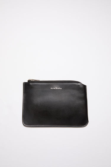 Acne Studios black zip wallet is crafted from soft grained leather with a silver stamped logo and features a metal zip fastening that opens to reveal a leather-lined interior to store your notes, cards and coins.
