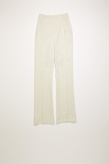 Acne Studios white melange linen trousers are cut to flared, slim-fitting legs with a high-rise waist, then finished with stitched folds through the front.