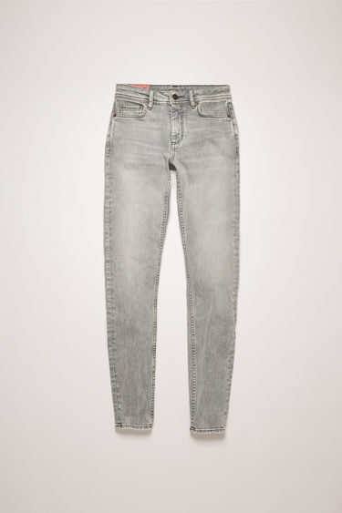 Acne Studios Climb Stone Grey jeans are crafted from super stretch denim that's washed to give a worn-in appeal. They're cut to a mid-rise waist with a skinny cropped leg and accented with subtle whiskering.