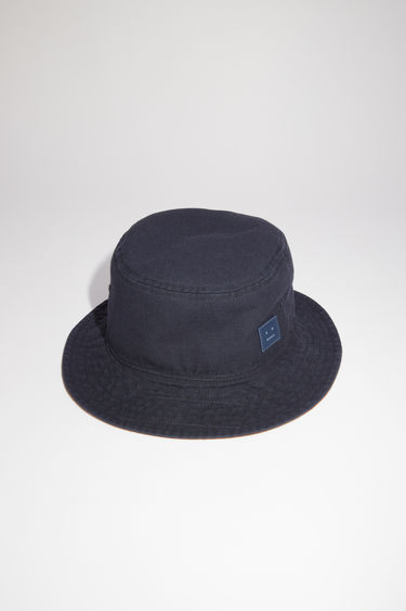 Acne Studios navy stonewashed twill bucket hat features a contrasting lining and tonal embroidered face patch.