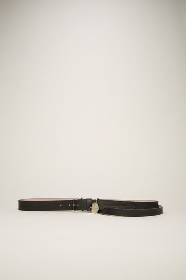 Acne Studios black/pink belt is crafted from matte grained leather with a long strap that drapes loosely across the hips and features a silver-tone buckle and an ID tag.