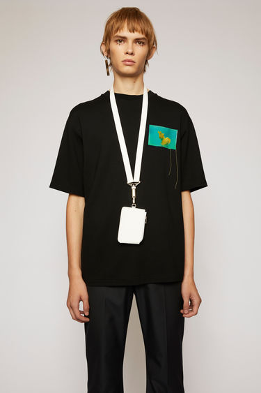 Acne Studios black t-shirt is made from technical interlock jersey and features a jellyfish-print patch across the chest.