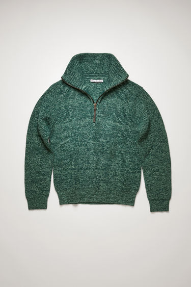 Acne Studios forest green/mint green sweater is knitted with different shades of wool yarn to a ribbed design and shaped with a zipped high neck and dropped shoulders.