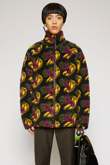 Acne Studios black zip-up jacket is crafted from soft fleece patterned with fruit motifs then finished with a funnel neck and a branded leather zip puller.