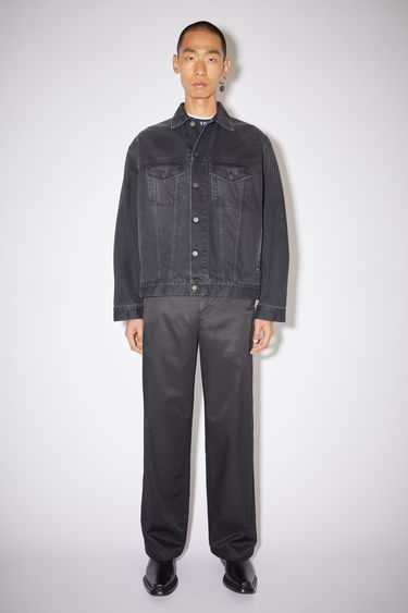 Acne Studios washed black denim jacket is made of cotton with a loose fit and a faded black wash.