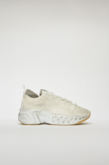 Acne Studios Manhattan Tumbled white sneakers takes cues from '90s American urban sportswear. They are crafted to a bulky silhouette with a lace up front and set on a sculpted platform sole. Every pair of sneakers are individually garment dyed to create a well-worn finish. The size runs larger, please take a size smaller than usual.
