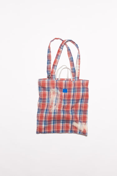 Acne Studios pink/blue organic cotton flannel tote bag features carrying handles and shoulder straps.
