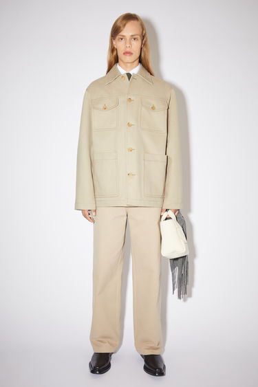 Acne Studios hazel beige shirt jacket is made of unlined cotton with a classic fit.