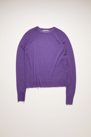 Acne Studios electric purple sweater is knitted from fine-gauge wool in subtly varying shades that create a melange finish. It's shaped with a round neckline and finished with distressed edges around the hem and cuffs.