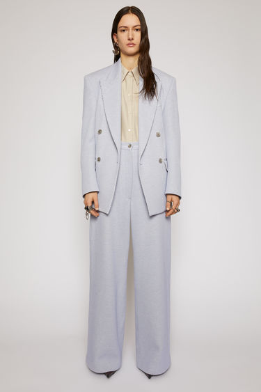 Acne Studios lilac/grey jumbo twill trousers take cues from men's workwear garments. They're tailored in a wide-leg shape that drapes loosely over the leg and designed with a traditional five-pocket design.