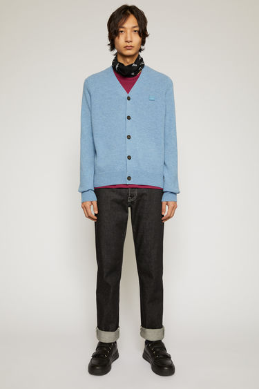Acne Studios mineral blue cardigan is knitted with a fine gauge from soft wool yarns and accented with a tonal face-embroidered patch on the chest.