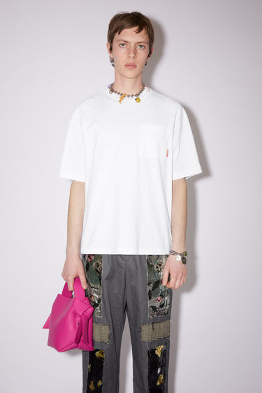 Acne Studios optic white crew neck t-shirt is made of cotton, featuring a single chest pocket with an Acne Studios logo tab.