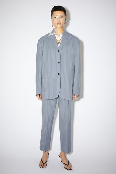 Acne Studios light blue/navy constructed suit jacket is made of pinstriped wool with an oversized fit.