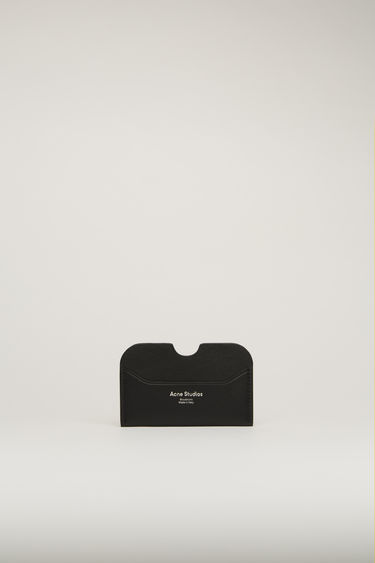 Acne Studios black card holder is made of soft grained leather with a silver logo stamp.