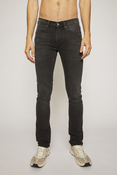Acne Studios Max Used Blk jeans are crafted from comfort stretch denim and shaped to sit low on a waistband before falling to slim legs. They feature subtle fading and whiskering to give a worn-in effect.
