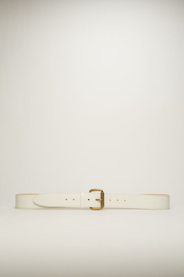 Acne Studios cold white belt is crafted to a wide dimension from high-shine leather and features an antiqued gold-tone buckle.