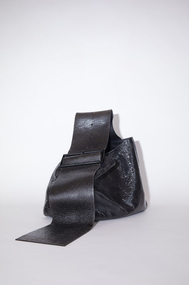 Acne Studios black/brown bucket bag is made of leather.