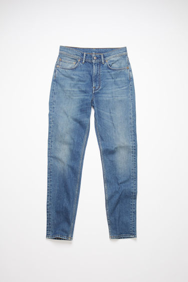 Acne Studios mid blue jeans are made from comfort stretch denim with a high rise and a slim, tapered leg.