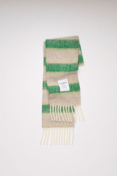 Acne Studios green/beige/lilac striped scarf is spun from a blend of alpaca, wool and mohair yarns in a relaxed long-length silhouette that drapes through the body. It's finished with a soft, brushed texture and a logo patch above the fringed edges.