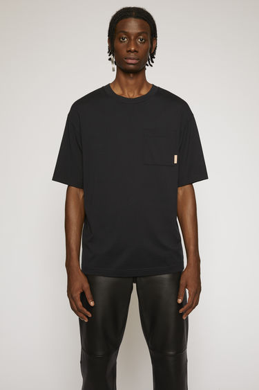 Acne Studios black t-shirt is cut to a boxy silhouette from soft cotton jersey and completed with a ribbed collar and a chest patch pocket.
