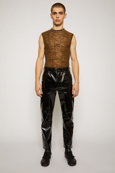 Acne Studios black trousers made from patent leather and cut in a straight-leg shape that's cropped at the ankles and have branded rivets and classic five pockets.