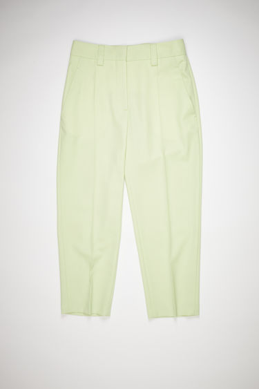 Acne Studios lemon yellow suit trousers are made of a wool blend with a tapered, cropped fit.